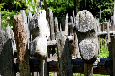 Wooden shoes on a fence